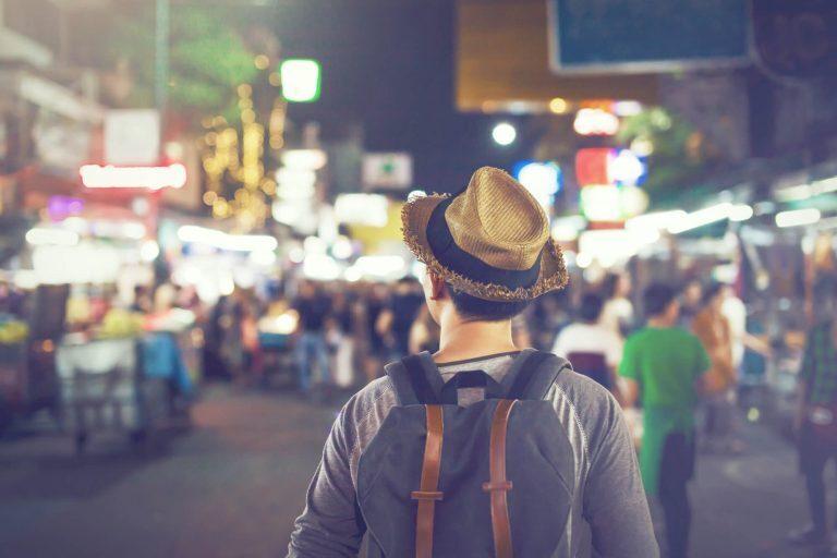 Man traveling through busy street