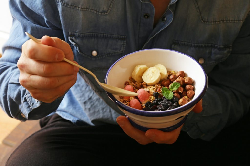 Cropped image of a man eating a healthy breakfast