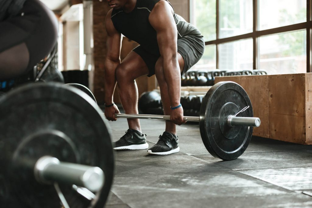 Cropped image of man weightlifting