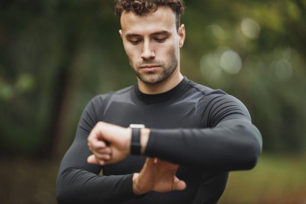 Man checking running watch