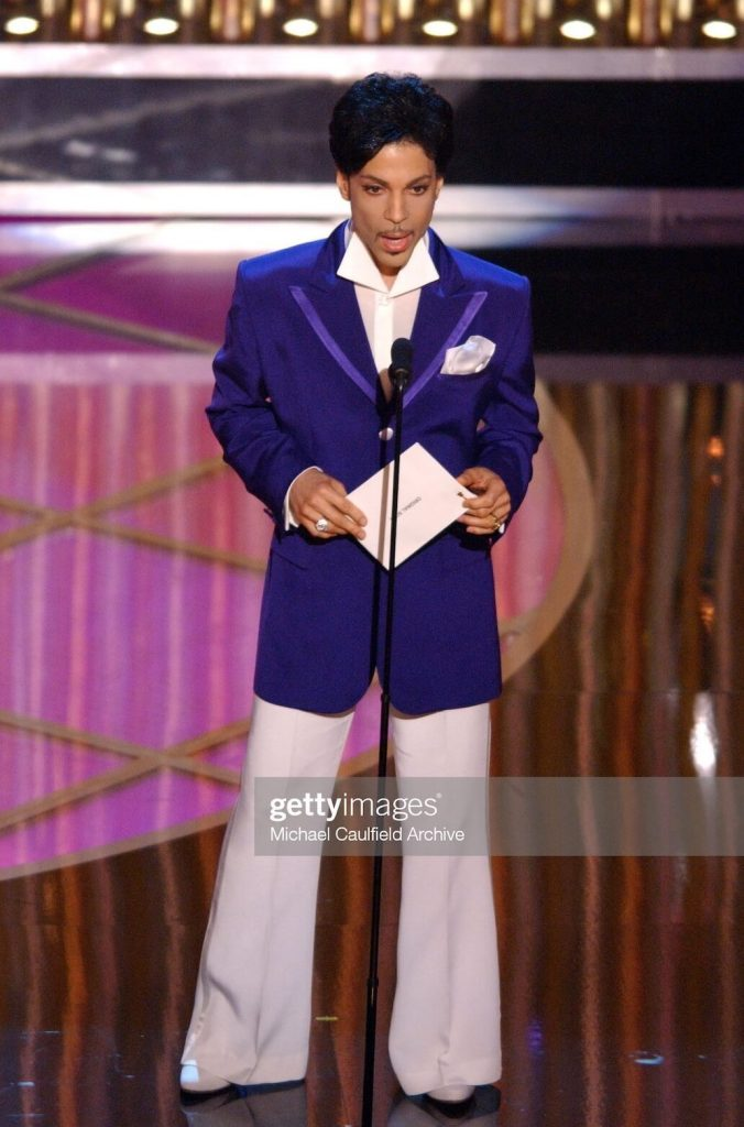 Prince in purple and white suit at Academy Awards