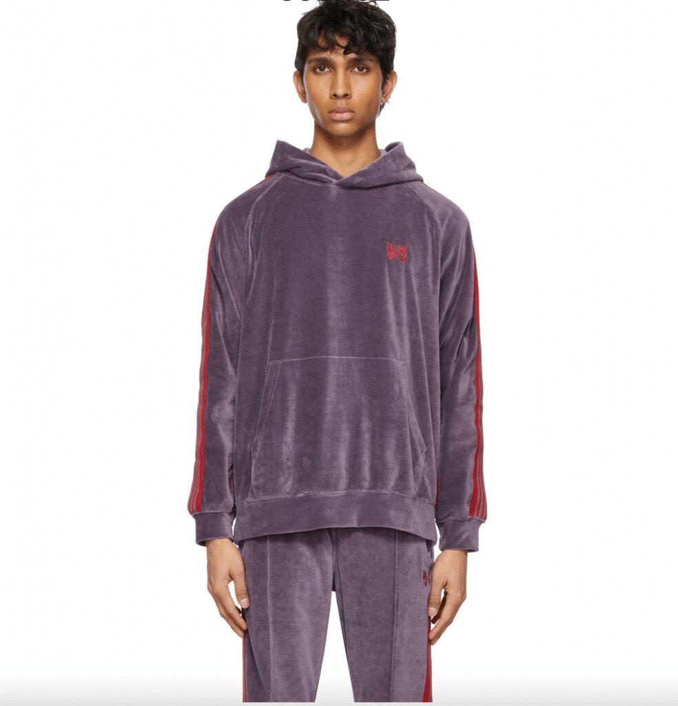 Man in Needles purple and red velour tracksuit
