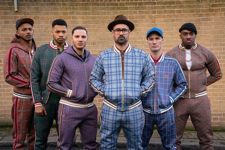 Colin Farrell and cast of The Gentlemen in different colored tracksuits