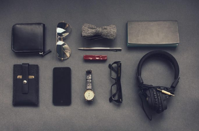 Men's accessories neatly laid out